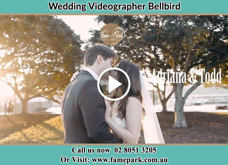 The newlyweds kissing in the park Bellbird NSW 2325
