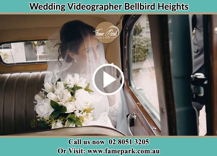 The Bride holding a bouquet of flowers inside the wedding car Bellbird Heights NSW 2325