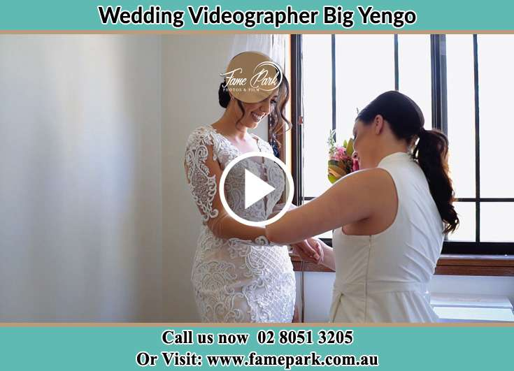 A woman helping the Bride to get ready for the wedding Big Yengo NSW 2330