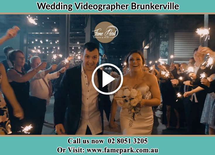 The newlyweds walking trough a cheering crowd Brunkerville NSW 2323