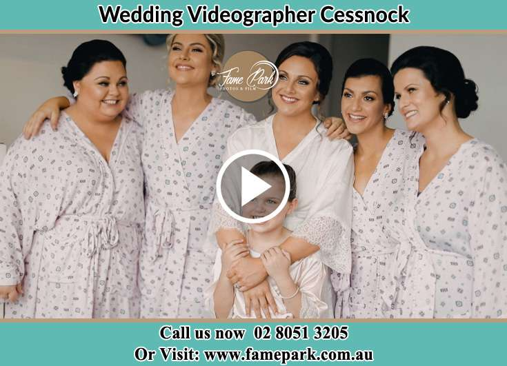 The Bride and her bridesmaids posing for the camera Cessnock