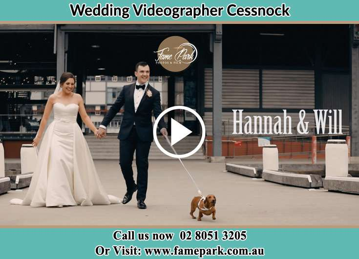 The Groom and the Bride walking with their dog.Cessnock