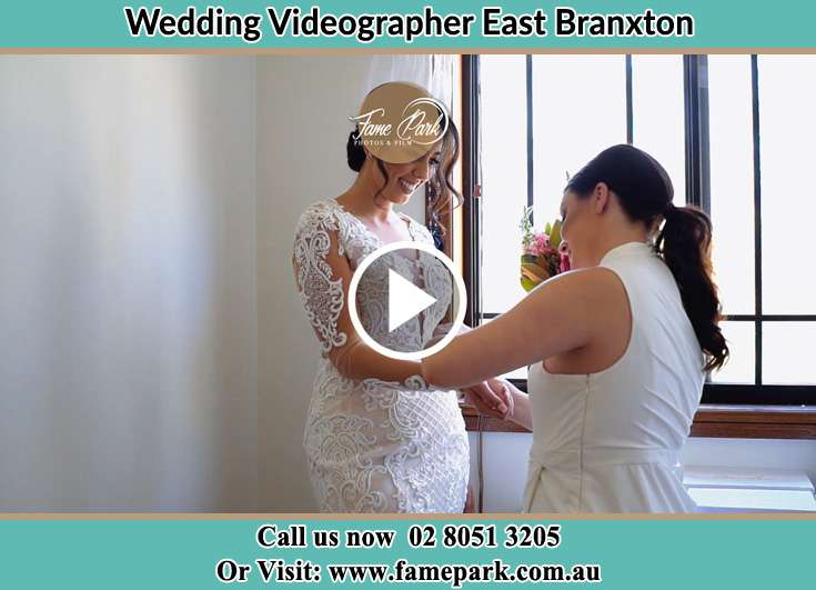 A woman helping the Bride to get ready for the wedding East Branxton NSW 2335