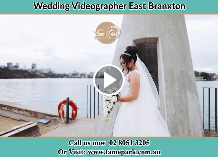 The Bride holding a bouquet of flowers near the shore East Branxton NSW 2335