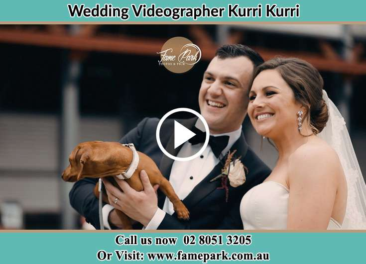 The newlyweds smiles for the camera with their dog Kurri Kurri NSW 2327