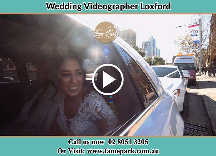 The Bride smiling inside the car Loxford NSW 2326