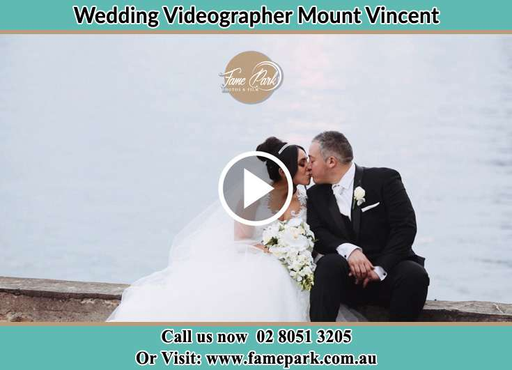 The newlyweds kissing near the shore Mount Vincent NSW 2323