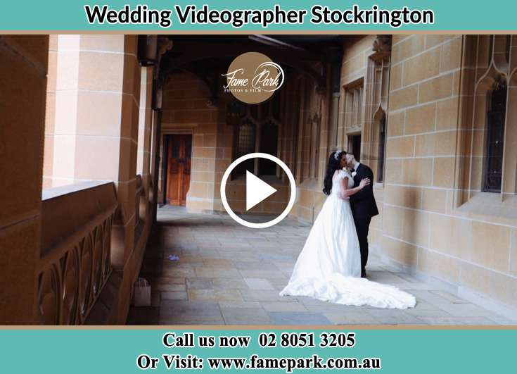 The Groom kissing the Bride in the hallway Stockrington NSW 2322